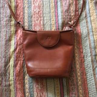 Louis Cardini tan bucket bag