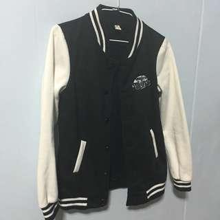 Black and white varsity baseball jacket