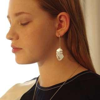 Face shaped earrings
