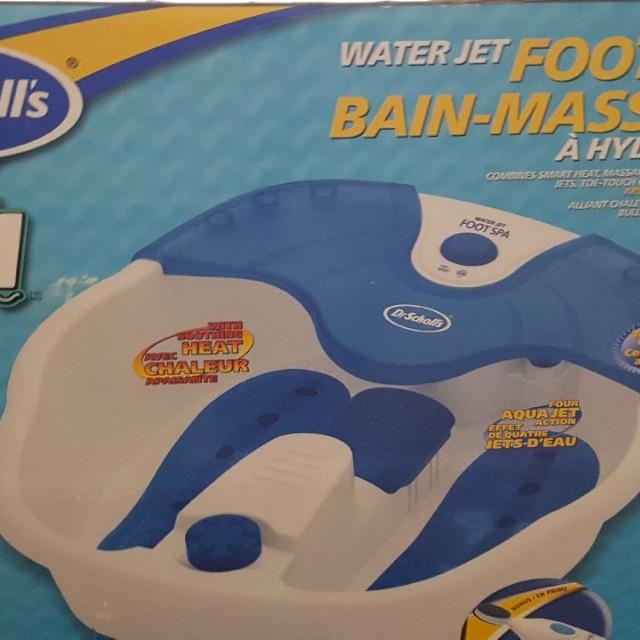 Dr. Schools massaging gel foot bath.