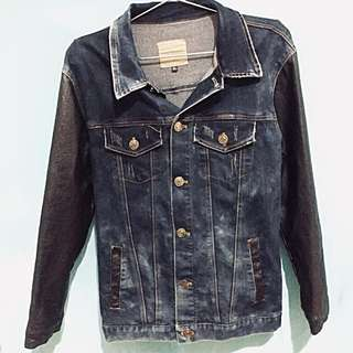Denim jacket with leather sleeves and details