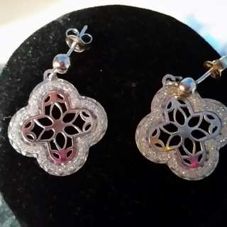 Sterling silver laser cut earrings.