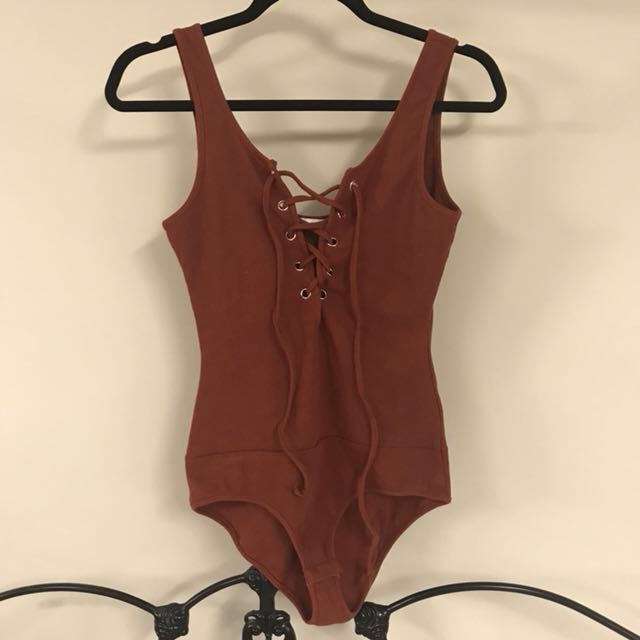 Valleygirl rust lace up bodysuit - sz small - never worn