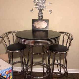 2 bar stools and table