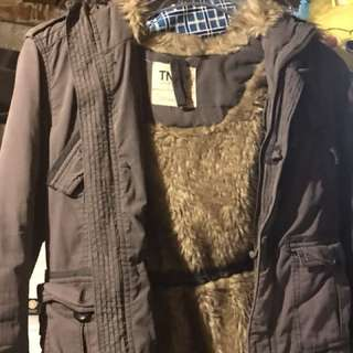 Selling a TNA parka size small grey in colour