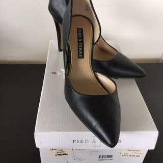 famous footwear black heels