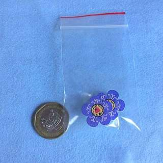 Small flower brooch: purplish blue