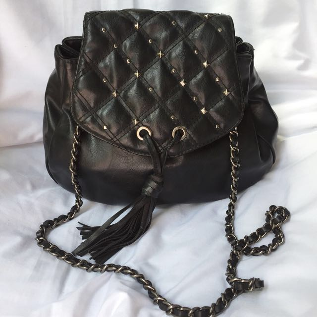 NINE WEST Quilted Two way sling and bag pack