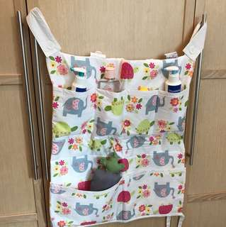 Baby's toiletries holder (for baby cots)
