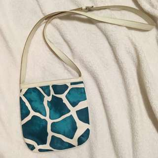 Leather teal giraffe print over shoulder purse