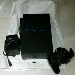 playstation two console with singe remote control and adaptor...