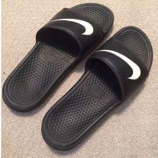Size 11 black Nike slip ons