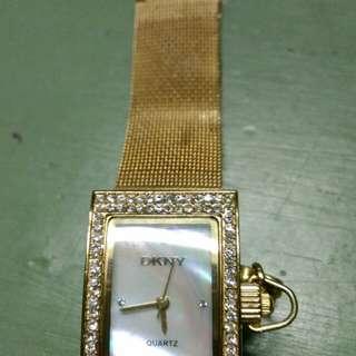 Gold DKNY watch Class A