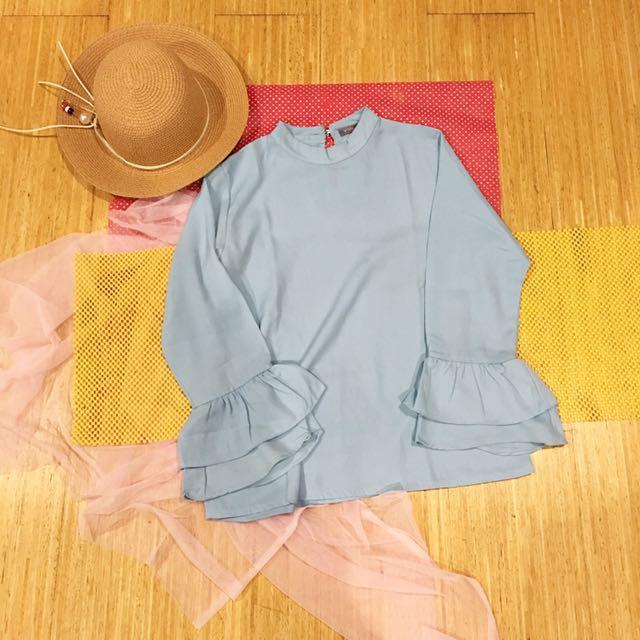 Trumpet baby blue blouse