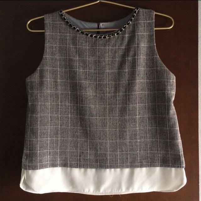 Chain sleeveless top