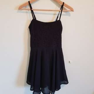 Black playsuit with side zipper