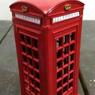 Telephone booth bills keeper