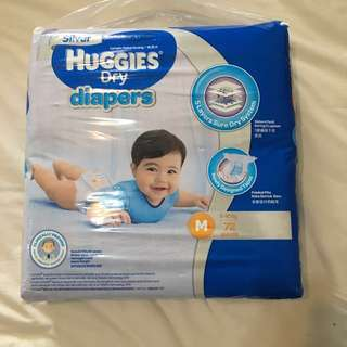 Silver Huggies dry diapers M size