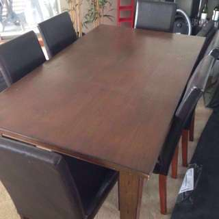 6 seater wooden dining table and chairs