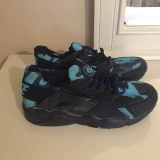 black-and-blue Nike Huarache shoes