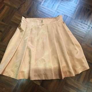 Light orange pleated skirt size 8