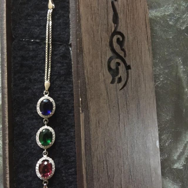 Pure gem sapphire stones set in a pure silver bracelet