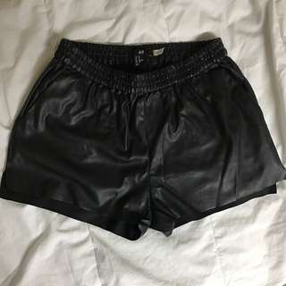 H&M black pleather shorts