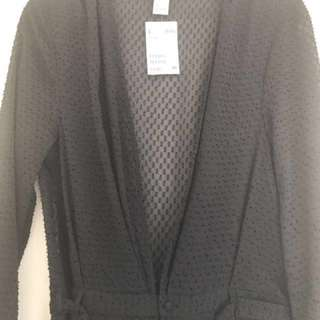 Brand new with tags HM jumpsuit. Sheer black fabric with low neck. Original price $79.99 size 8