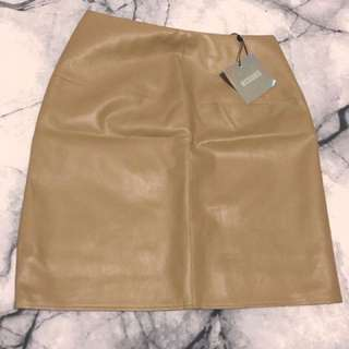 Size 10 tan faux leather mini skirt