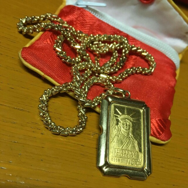 Selling Gold Necklace with Liberty Pendant