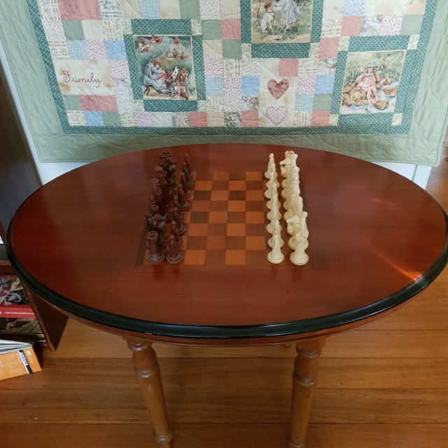 Oval inlay walnut chess table