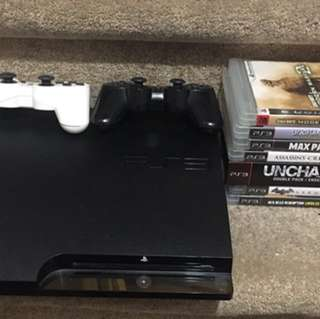 Sony PS3 Slim console with controllers and games