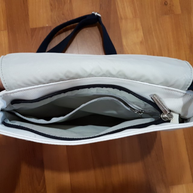 05c58d3d15 Fila white sling bag with simple style for ladies