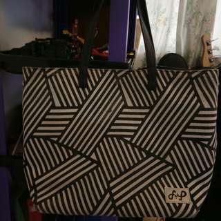 FlipBag Reversable stripe print and leather bag