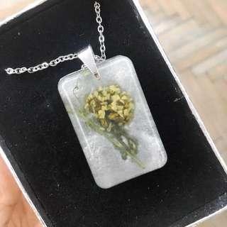 Flower in metal pendant