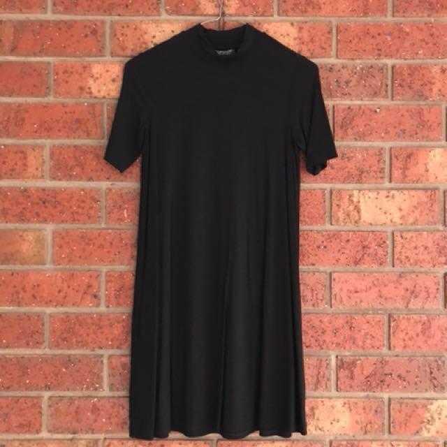 Black swing dress with slight turtle neck size 6