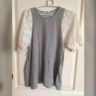Top with eyelet sleeves