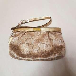 Coach gold pouch 100% Genuine