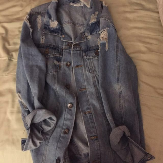 Distressed oversized ripped jean jacket