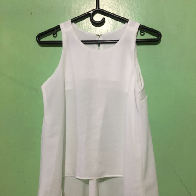 White sleevless top