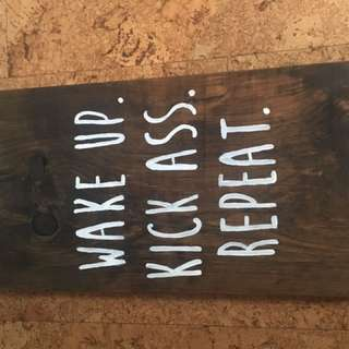 "Sign "" wake up, kick ass , repeat"""