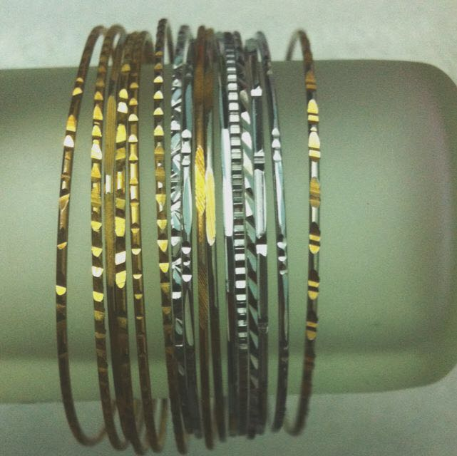 Assorted Gold And Silver Bangles