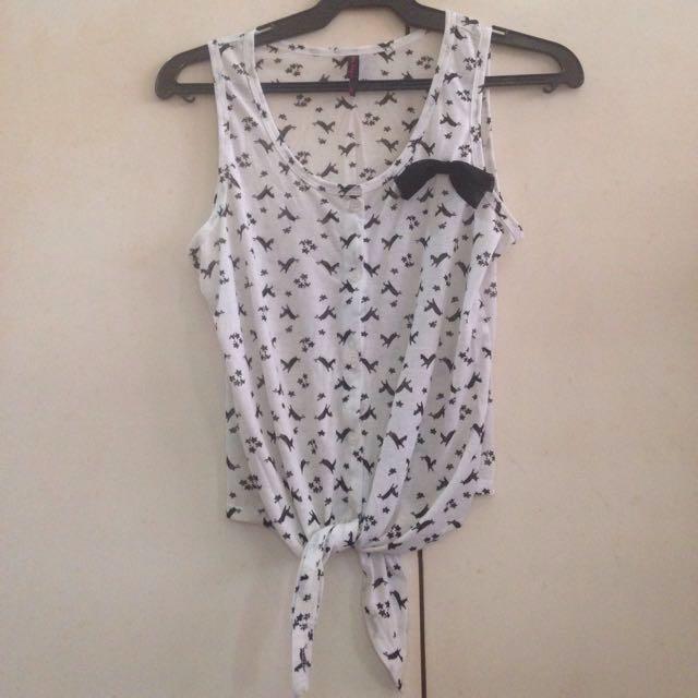White sleeveless with black animal prints bow bottom