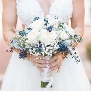 Bridal Bouquet in White Roses and White Baby Breath with Rustic Fillers Caspia and Nuts