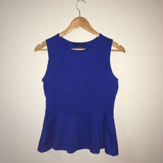Blue Sleeveless Peplum Top