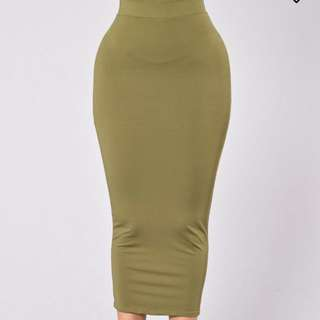 A long green skirt high waisted perfect for any event/occasion