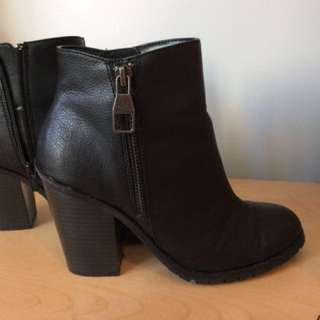 Black leather side zip ankle booties from Spring