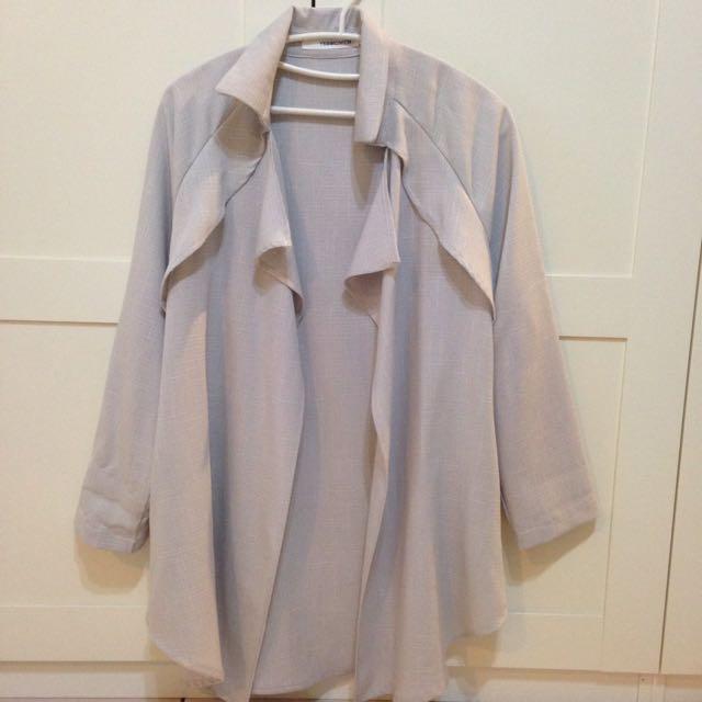 類棉麻材質個性風衣