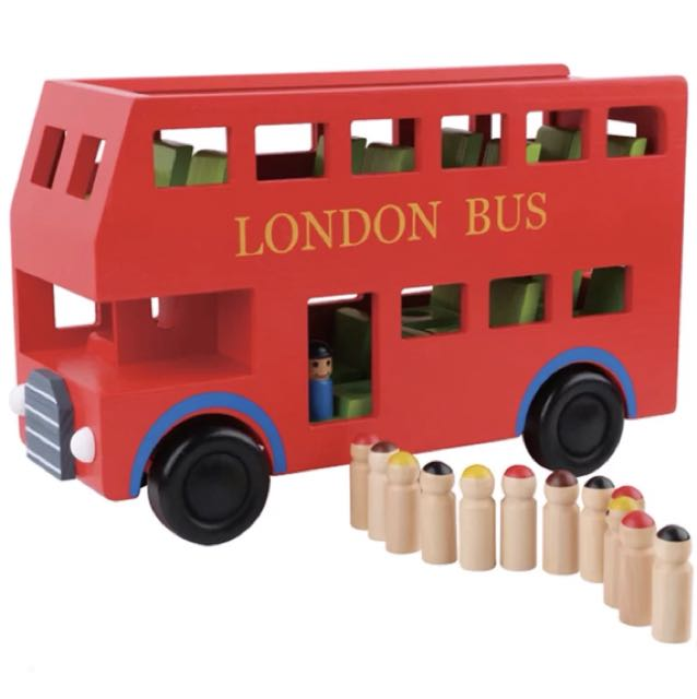 Brand new wooden London double decker bus with passengers