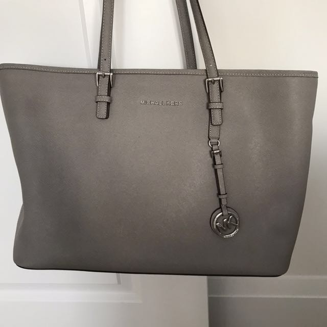Grey Michael Kors large purse.